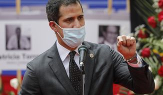 Opposition leader Juan Guaido speaks during an event by health workers to honor their colleagues who have died of COVID-19 in Caracas, Venezuela, Thursday, Sept. 10, 2020. (AP Photo/Ariana Cubillos)