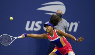 Naomi Osaka, of Japan, returns a shot to Jennifer Brady, of the United States, during a semifinal match of the US Open tennis championships, Thursday, Sept. 10, 2020, in New York. (AP Photo/Seth Wenig)
