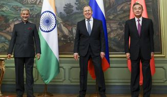 In this photo released by the Russian Foreign Ministry Press Service, India's Foreign Minister S. Jaishankar, left, Russia's Foreign Minister Sergey Lavrov, and China's Foreign Minister Wang Yi, pose for a photo on the sidelines of a meeting of Foreign Ministers of Shanghai Cooperation Organisation, Commonwealth of Independent States and Collective Security Treaty Organization Member States in Moscow, Russia, Thursday, Sept. 10. 2020. (Russian Foreign Ministry Press Service via AP)