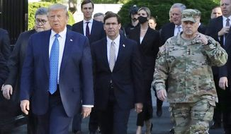 In this June 1, 2020, file photo, President Donald Trump departs the White House to visit outside St. John's Church, in Washington. Walking behind Trump from left are, Attorney General William Barr, Secretary of Defense Mark Esper and Gen. Mark Milley, chairman of the Joint Chiefs of Staff. (AP Photo/Patrick Semansky, File)
