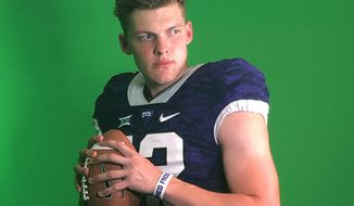 In this photo taken on July 27, 2019, German quarterback Alexander Honig poses for a photo ina TCU uniform after participating in a football camp at the Big 12 Conference school in Fort Worth, Texas. TCU offered Honig a scholarship after the workout.  Honig looks and sounds the part of big-time American college football recruit. The quarterback is nearly 6-foot-6 and 235 pounds. He has a scholarship offer to play at TCU. But the unusual part is Honig is German. It's rare for an American college program to recruit a European as a quarterback. The 18-year-old Honig is taking his talents from Bavaria to Texas with dreams of becoming an NFL QB. (Susanne Honig via AP)