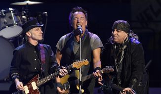 """In this March 15, 2016, file photo, Bruce Springsteen, center, performs with Nils Lofgren, left, and Steven Van Zandt of the E Street Band during their concert at the Los Angeles Sports Arena in Los Angeles. Springsteen will release a new rock album he recorded live in his New Jersey home studio with the E Street Band. The Boss said Thursday, Sept. 10, 2020, the album is called """"Letter to You"""" and he and the band recorded it in just five days. It will be released on Oct. 23. (Photo by Chris Pizzello/Invision/AP, File)"""