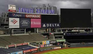 Dark clouds move beyond the empty stands and outfield at Yankee Stadium where a baseball game between the New York Yankees and the Baltimore Orioles was postponed, Thursday, Sept. 10, 2020, in New York. The game was rescheduled for Friday before the scheduled night game between the two teams. (AP Photo/Kathy Willens)
