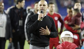 FILE - In this Oct. 28, 2018, file photo, New York Red Bulls head coach Chris Armas speaks to the fans after an MLS soccer match against Orlando City in Harrison, N.J. New York Red Bulls have fired coach Chris Armas after a little more than two years on the job. The MLS team also said Friday, Sept. 4, 2020, that assistant coach CJ Brown will not be back. (AP Photo/Steve Luciano, File)