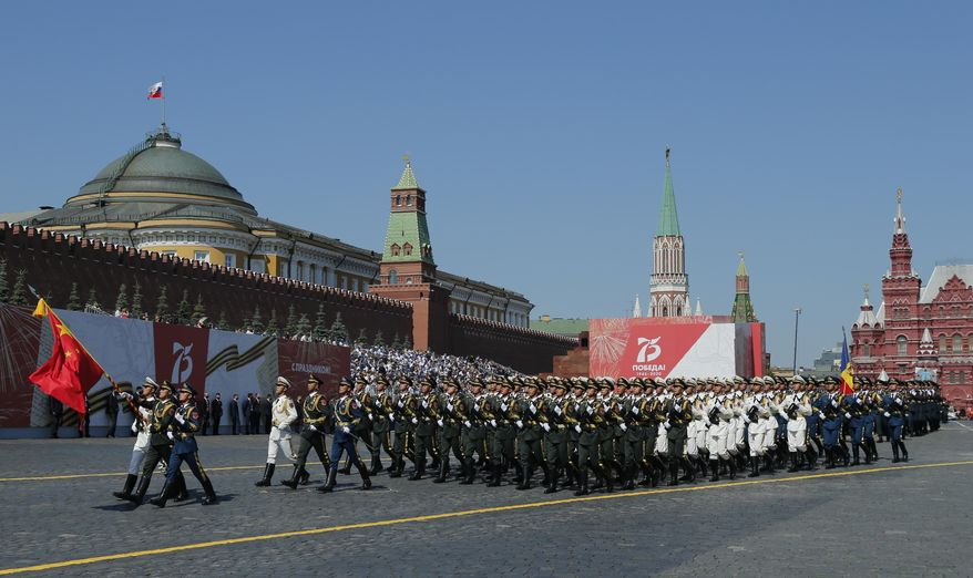 In this June 24, 2020, photo, soldiers from China's People's Liberation Army march toward Red Square during the Victory Day military parade marking the 75th anniversary of the Nazi defeat in Red Square in Moscow, Russia. Chinese and Russian forces will take part in joint military exercises in southern Russia later in September along with troops from Armenia, Belarus, Iran, Myanmar, Pakistan and others, China's defense ministry announced Thursday, Sept. 10, 2020. (AP Photo/Alexander Zemlianichenko) **FILE**