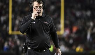 FILE - In this Nov. 2, 2019, file photo, South Carolina head coach Will Muschamp walks on the sideline during the second half of an NCAA college football game in Columbia, S.C. Muschamp haven't had a true quarterback competition since 2016 _ and he's taking much of the way through camp as Ryan Hilinski, Collin Hill and Luke Doty try to become the Gamecocks' passer. (AP Photo/Sean Rayford, File)