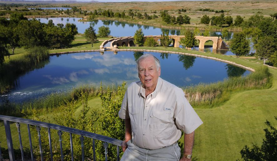 FILE - In this May 30, 2017, file photo, oil tycoon T. Boone Pickens poses for a photo on his Mesa Vista Ranch in the panhandle of Texas. Works of art depicting the American West and other items collected by the late Texas oil tycoon T. Boone Pickens are expected to sell for more than $15 million at an auction. Christie's announced Thursday, Sept. 10, 2020 that the auction will be held Oct. 28 in New York. (Tom Fox/The Dallas Morning News via AP, File)