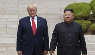 """FILE - In this June 30, 2019, file photo, President Donald Trump, left, meets with North Korean leader Kim Jong Un at the North Korean side of the border at the village of Panmunjom in Demilitarized Zone. Journalist Bob Woodward's book """"Rage,"""" includes new details about the president's comments on Kim Jong Un, racial unrest and a mysterious new weapon that Trump says other world powers don't know about. (AP Photo/Susan Walsh, File)"""