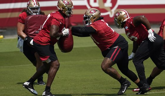 San Francisco 49ers' William Sweet, left, and Trent Williams perform a drill during NFL football practice in Santa Clara, Calif., Wednesday, Sept. 2, 2020. (AP Photo/Jeff Chiu, Pool)