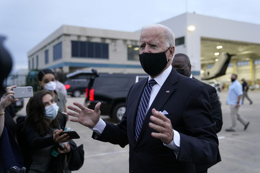 Democratic presidential candidate and former Vice President Joe Biden speaks with reporters before boarding a plane at New Castle Airport in New Castle, Del., Friday, Sept. 11, 2020. Biden is traveling to New York and Shanksville, Pa., to commemorate the 19th anniversary of the Sept. 11, 2001, terrorist attacks. (AP Photo/Patrick Semansky)