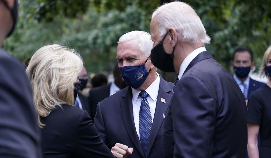 Democratic presidential candidate former Vice President Joe Biden greets Vice President Mike Pence at the 19th anniversary ceremony in observance of the Sept. 11 terrorist attacks at the National September 11 Memorial & Museum in New York, on Friday, Sept. 11, 2020.  (AP Photo/Mary Altaffer)