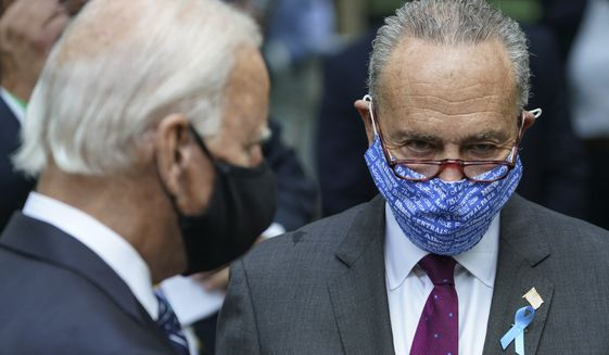 Senate Minority Leader Sen. Chuck Schumer of N.Y., right, speaks with Democratic presidential candidate and former Vice President Joe Biden, left, at the National September 11 Memorial and Museum, Friday, Sept. 11, 2020, in New York. (AP Photo/John Minchillo) ** FILE **