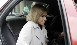 In this May 15, 2009, photo, then-acting U.S. Attorney Nora Dannehy leaves law offices in Washington. Dannehy, a federal prosecutor who was helping lead the investigation into the origins of the Trump-Russia probe, has resigned from the Justice Department. (AP Photo/Haraz N. Ghanbari) **FILE**