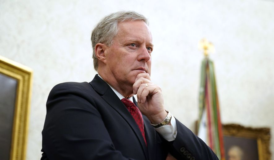Chief of Staff Mark Meadows listens as President Donald Trump speaks in the Oval Office of the White House on Friday, Sept. 11, 2020, in Washington. (AP Photo/Andrew Harnik)
