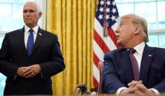 President Donald Trump looks towards Vice President Mike Pence in the Oval Office of the White House on Friday, Sept. 11, 2020, in Washington. Bahrain has become the latest Arab nation to agree to normalize ties with Israel as part of a broader diplomatic push by Trump and his administration to fully integrate the Jewish state into the Middle East. (AP Photo/Andrew Harnik)