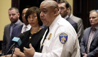 FILE - In this Monday, Feb. 11, 2019 file photo, Michael Harrison, acting commissioner of the Baltimore Police Department, speaks at an introductory news conference in Baltimore. The Baltimore Police Department has revealed the aerial surveillance system being tested in the city since May has provided officers evidentiary information in 81 cases, including 19 homicides. But the department on Friday. Sept. 11, 2020 also acknowledged it does not have enough data yet to determine the effectiveness of the pilot program.  (AP Photo/Patrick Semansky, File)