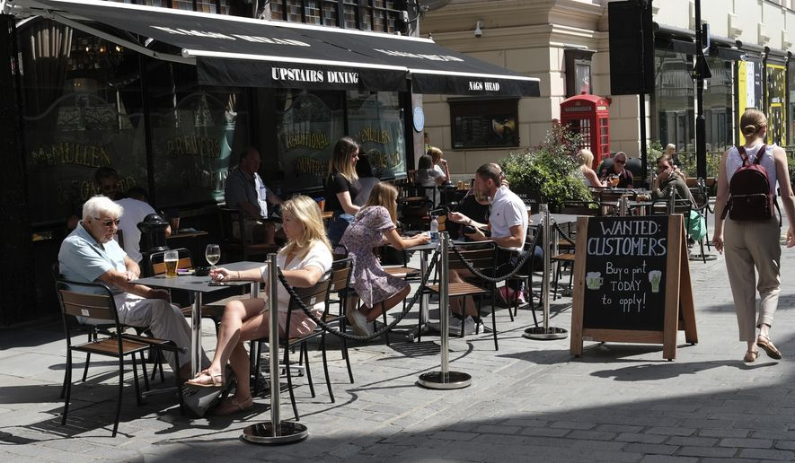 "FILE - In this Monday, Aug. 3, 2020 file photo, a sign outside a pub reads: ""Wanted Customers"" in central London. The British economy recouped some further lost ground during July after a swath of coronavirus restrictions were lifted, official figures showed Friday Sept. 11, 2020. However, it still has to make up around half the output lost at the peak of the lockdown and now faces renewed risks related to Brexit. (AP Photo/Alastair Grant, file)"