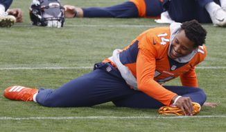 Denver Broncos wide receiver Courtland Sutton stretches before taking part in drills during an NFL football practice Thursday, Sept. 10, 2020, in Englewood, Colo. (AP Photo/David Zalubowski)