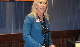 FILE - In this March 3, 2020, file photo, Republican Marjorie Taylor Greene speaks to a GOP women's group in Rome, Ga. The Democratic candidate running against Republican Marjorie Taylor Greene, who has expressed support for the QAnon conspiracy theory and been criticized for other incendiary comments, is dropping out of their race for a U.S. House seat representing northwest Georgia. Democrat Kevin Van Ausdal bowed out of the race on Friday, Sept. 11, 2020.  (John Bailey/The Rome News-Tribune via AP, File)