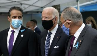 Democratic presidential candidate and former Vice President Joe Biden walks Sen. Chuck Schumer, D-N.Y., right, and New York Gov. Andrew Cuomo, at the National September 11 Memorial in New York, Friday, Sept. 11, 2020, before a ceremony marking the 19th anniversary of the Sept. 11 terrorist attacks. (AP Photo/Patrick Semansky)