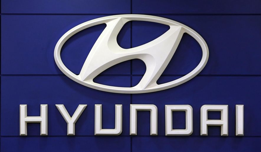 FILE - In this July 26, 2018 file photo, the logo of Hyundai Motor Co. is seen at its showroom in Seoul, South Korea. For the second time this month, Hyundai is telling some SUV owners to park outdoors because an electrical short in a computer can cause vehicles to catch fire. The Korean automaker is recalling about 180,000 Tucson SUVs in the U.S. from 2019 through 2021 to fix the problem.  (AP Photo/Ahn Young-joon, File)