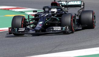 Mercedes driver Valtteri Bottas of Finland steers his car during the first practice session ahead of the Grand Prix of Tuscany at the Mugello circuit in Scarperia, Italy, Friday, Sept. 11, 2020. The Formula One Grand Prix of Tuscany will take place on Sunday. (AP Photo/Luca Bruno)