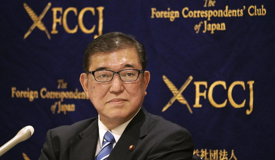 Shigeru Ishiba, member of House of Representatives of Liberal Democratic Party (LDP) and one of candidates for LDP leadership election speaks during his press conference Friday, Sept. 11, 2020, in Tokyo. In response to Japan's Prime Minister Shinzo Abe's suggestion Japan should change its defense policy, Ishiba explained that Japan does not have a capability, and it would take a lot of time and cost to be able to acquire such a capability, and Japan would have to rely on the U.S. for surveillance. (AP Photo/Eugene Hoshiko)