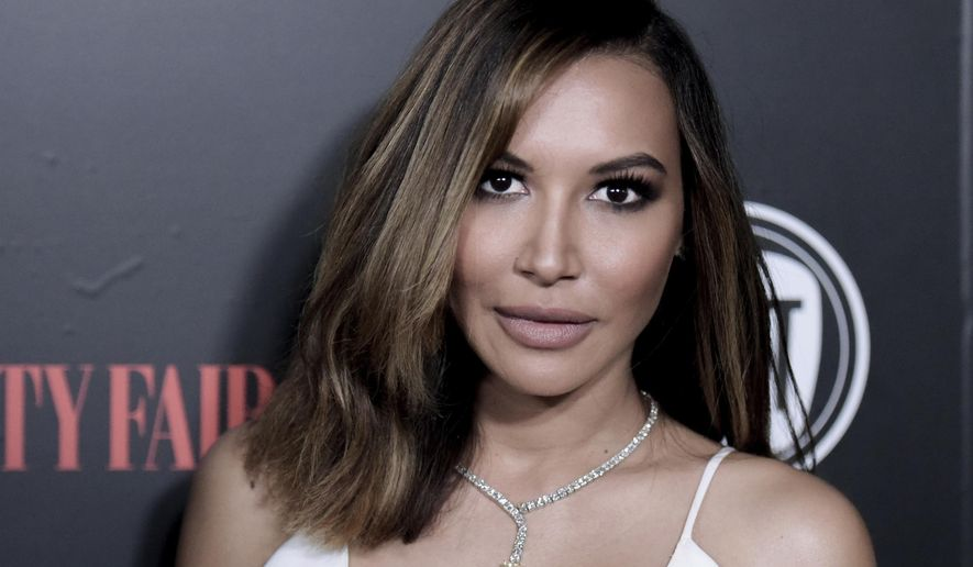 """FILE - In this Feb. 23, 2016, file photo, actress Naya Rivera attends Vanity Fair and FIAT Celebration of Young Hollywood in West Hollywood, Calif. An autopsy report released Friday, Sept. 11, 2020 says """"Glee"""" actor Naya Rivera raised her arm and called for help as she accidentally drowned while boating with her 4-year-old son on a California lake.  (Photo by Richard Shotwell/Invision/AP, File)"""
