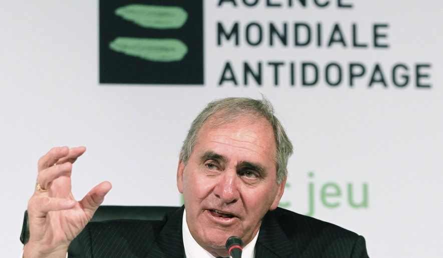 FILE - In this Nov. 12, 2013, file photo, John Fahey, president of the World Anti-Doping Agency (WADA), speaks during a news conference in Johannesburg, South Africa. Fahey, a former president of the World Anti-Doping Agency and a key player in getting the 2000 Summer Olympics for Sydney, has died. He was 75. New South Wales state government officials on Saturday, Sept. 12, 2020, confirmed Fahey's death. (AP Photo/Themba Hadebe, File)