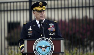 Chairman of the Joint Chiefs Gen. Mark Milley speaks during a ceremony at the National 9/11 Pentagon Memorial to honor the 184 people killed in the 2001 terrorist attack on the Pentagon, in Washington, Friday Sept. 11, 2020. (AP Photo/J. Scott Applewhite)
