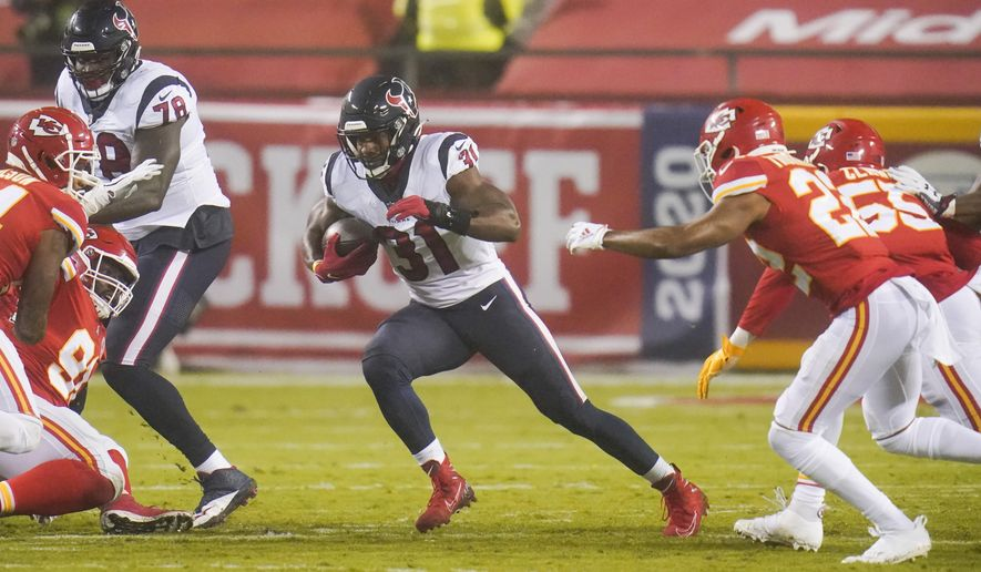 Houston Texans running back David Johnson (31) carries the ball against the Kansas City Chiefs in the second half of an NFL football game Thursday, Sept. 10, 2020, in Kansas City, Mo. (AP Photo/Jeff Roberson)
