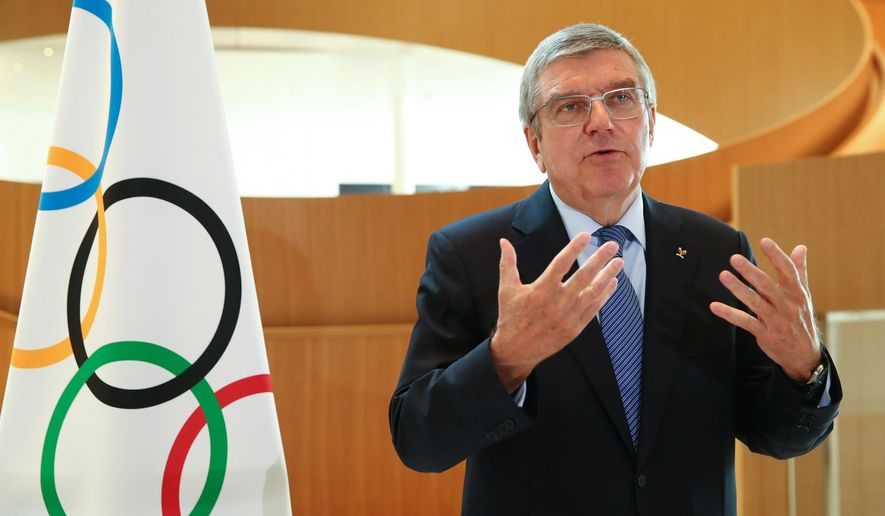 FILE - In this March 25, 2020, file photo, Thomas Bach, president of the International Olympic Committee (IOC), attends an interview after the decision to postpone the Tokyo 2020 Olympic Games because of the coronavirus disease (COVID-19) outbreak, in Lausanne, Switzerland. Bach suggested that the Tokyo Olympics are a moving target. (Denis Balibouse/Keystone via AP, File)