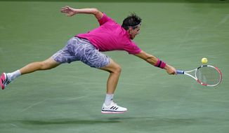 Dominic Thiem, of Austria, stretches for a return against Alex de Minaur, of Australia, during the quarterfinal round of the US Open tennis championships, Wednesday, Sept. 9, 2020, in New York. (AP Photo/Frank Franklin II)