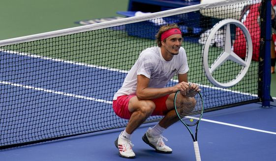Alexander Zverev, of Germany, reacts during a match against Borna Coric, of Croatia, during the quarterfinals of the US Open tennis championships, Tuesday, Sept. 8, 2020, in New York. (AP Photo/Seth Wenig)