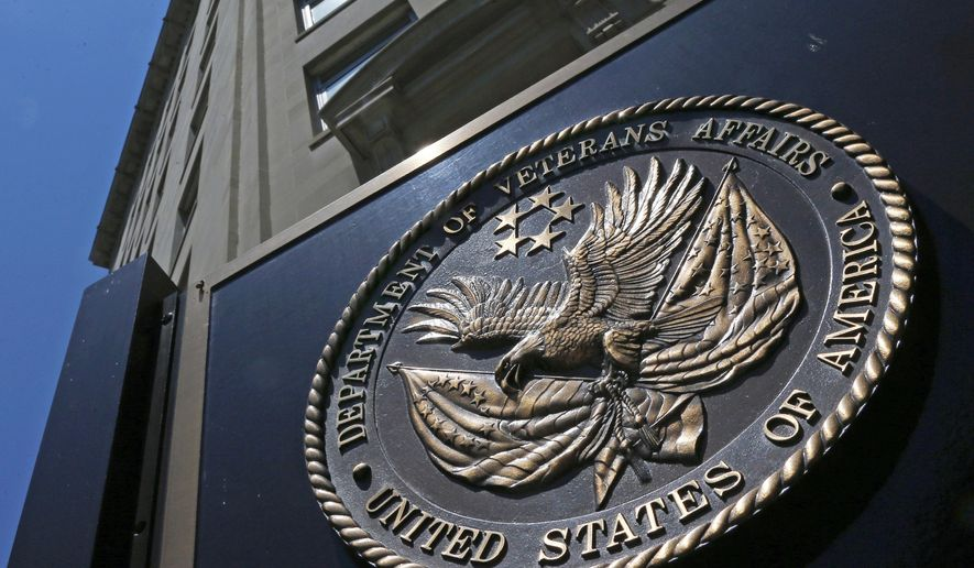 This June 21, 2013, file photo, shows the seal affixed to the front of the Department of Veterans Affairs building in Washington. (AP Photo/Charles Dharapak, File)  ** FILE **