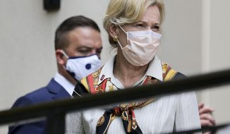 Dr. Deborah Birx, a high-ranking member of President Trump's coronavirus response team, exits Sid McDonald Hall to conduct a press conference at the University of Alabama Friday Sept. 11, 2020, in Tuscaloosa, Ala. (Gary Cosby Jr./The Tuscaloosa News via AP)