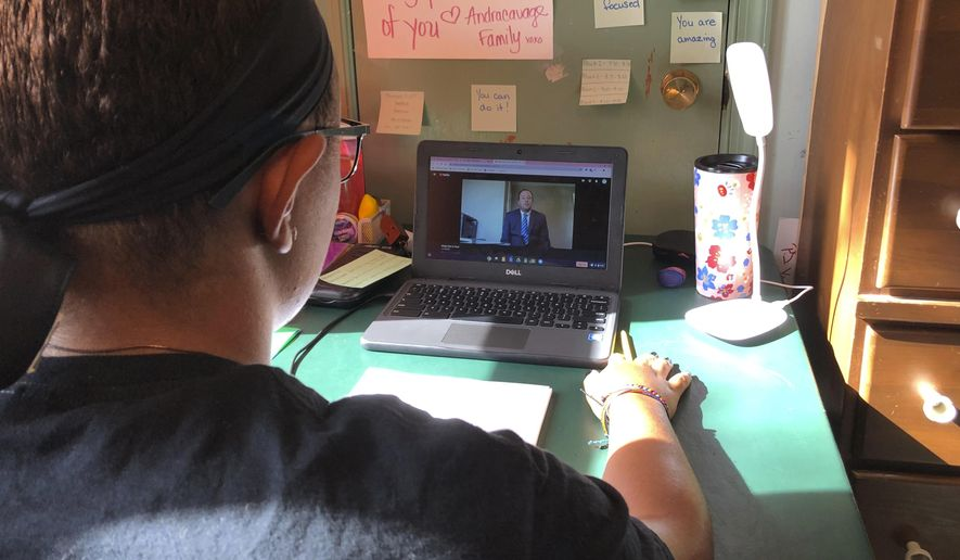Katie Griffin, a junior at Norristown Area High School, takes part in virtual Spanish class at her home in Norristown, Pa., on Thursday, Sept. 3, 2020. The district plans to offer online-only instruction through at least January 2021. (AP Photo/Michael Rubinkam)