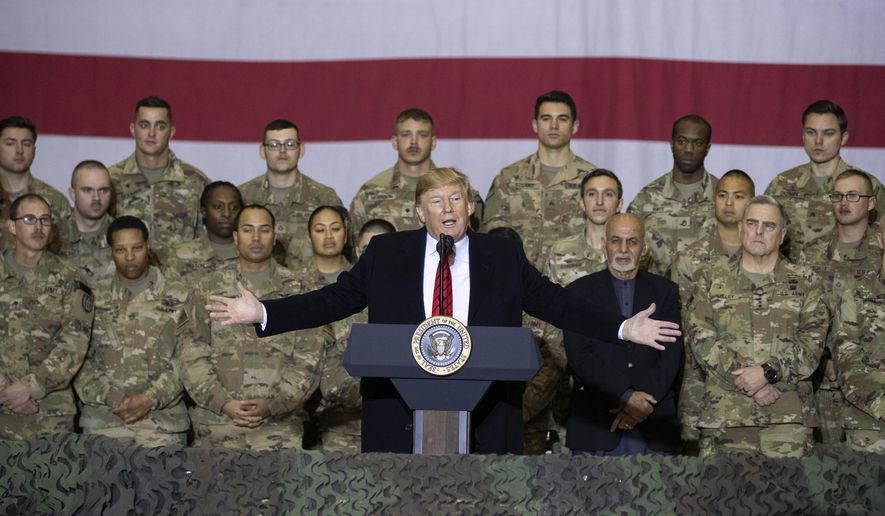 """In this Nov. 28, 2019, file photo, President Donald Trump, center, with Afghan President Ashraf Ghani and Joint Chiefs Chairman Gen. Mark Milley, behind him at right, addresses members of the military during a surprise Thanksgiving Day visit at Bagram Air Field, Afghanistan. During his election campaign four years ago, Trump vowed to bring all troops home from endless wars."""" In recent months, he's only increased the pressure, working to fulfill his campaign promise and get forces home before Election Day. (AP Photo/Alex Brandon, File)"""