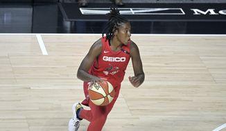 Washington Mystics guard Ariel Atkins (7) drives to the basket during the first half of a WNBA basketball game against the Los Angeles Sparks, Thursday, Sept. 10, 2020, in Bradenton, Fla. (AP Photo/Phelan M. Ebenhack)  **FILE**