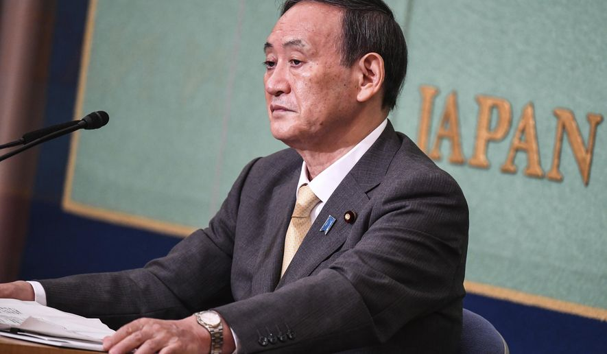 Japan's Liberal Democratic Party's leadership election candidate and Japan's Chief Cabinet Secretary Yoshihide Suga attends a debate ahead of the LDP's leadership election, in Tokyo Saturday, Sept. 12, 2020. The party plans a vote on Sept. 14 to choose Shinzo Abe's replacement as party chief. (Charly Triballeau/Pool Photo via AP)