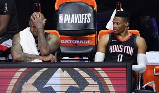 Houston Rockets' P.J. Tucker, left, and Russell Westbrook sit on the bench in the closing minutes of a loss to the Los Angeles Lakers during the second half of an NBA conference semifinal playoff basketball game Saturday, Sept. 12, 2020, in Lake Buena Vista, Fla. (AP Photo/Mark J. Terrill)