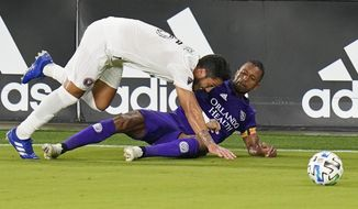 Inter Miami's Nicolas Figal, left, and Orlando City's Nani stumble while going for the ball during the first half of an MLS soccer match Saturday, Sept. 12, 2020, in Orlando, Fla. (AP Photo/John Raoux)