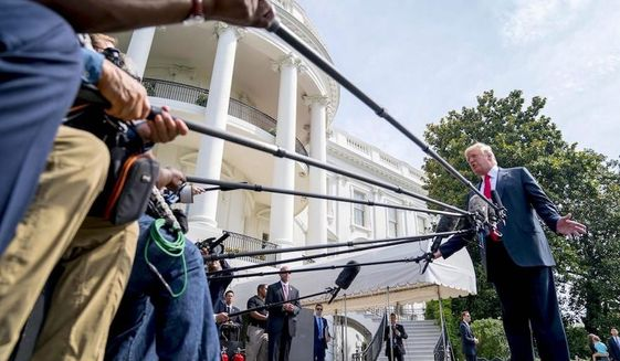 """A warning is up that the traditional """"October surprise"""" of partisan attacks directed at President Trump now can be found in September. (Associated Press)"""