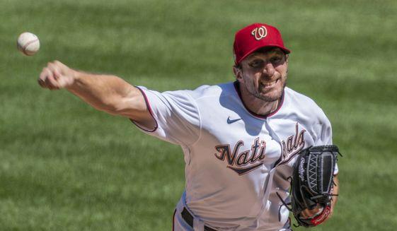Washington Nationals starting pitcher Max Scherzer throws during the first inning of a baseball game against the Atlanta Braves in Washington, Sunday, Sept. 13, 2020. (AP Photo/Manuel Balce Ceneta) **FILE**