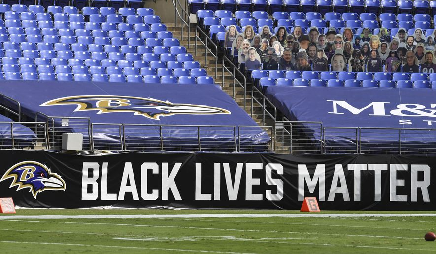 A Black Lives Matters sign sits along the sideline of M&T Bank Stadium before an NFL football game between the Baltimore Ravens and Cleveland Browns, Sunday, Sept. 13, 2020, in Baltimore. (AP Photo/Terrance Williams)
