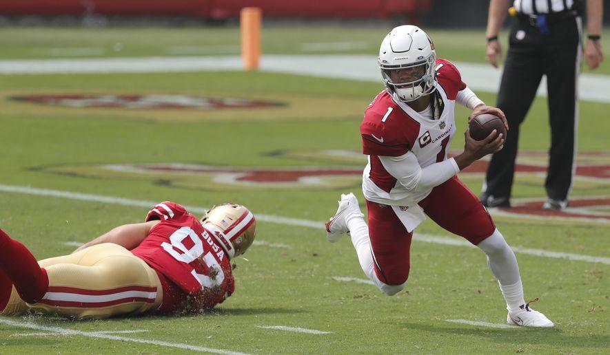 Arizona Cardinals quarterback Kyler Murray (1) scrambles from San Francisco 49ers defensive end Nick Bosa during the first half of an NFL football game in Santa Clara, Calif., Sunday, Sept. 13, 2020. (AP Photo/Josie Lepe)