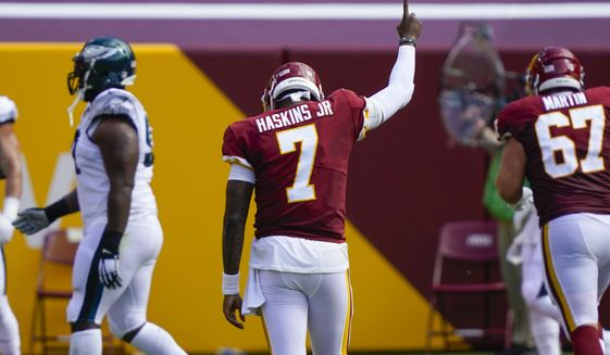 Washington Football Team quarterback Dwayne Haskins (7) gestures after throwing a touchdown pass to teammate tight end Logan Thomas (82) in the first half of an NFL football game against the Philadelphia Eagles, Sunday, Sept. 13, 2020, in Landover, Md. (AP Photo/Alex Brandon)