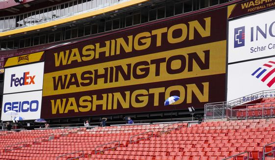 Fedex Field scoreboard displays the Washington Football Team name during warmups before the start of a NFL football game between Washington Football Team and Philadelphia Eagles, Sunday, Sept. 13, 2020, in Landover, Md. (AP Photo/Susan Walsh)  **FILE**