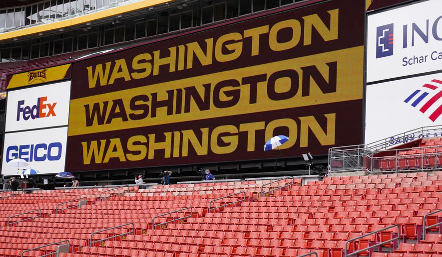 Fedex Field scoreboard displays the Washington Football Team name during warmups before the start of a NFL football game between Washington Football Team and Philadelphia Eagles, Sunday, Sept. 13, 2020, in Landover, Md. (AP Photo/Susan Walsh)