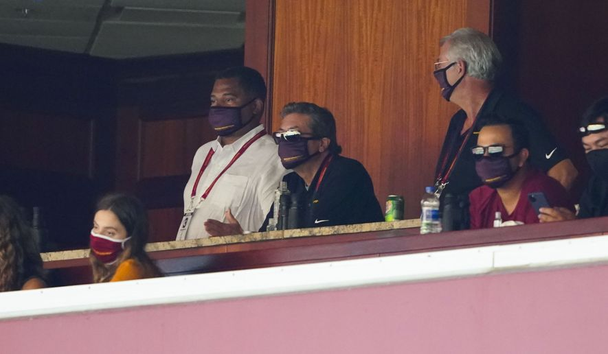 Washington Football Team owner Dan Snyder, center, watches from owner's box the second half of an NFL football game against the Philadelphia Eagles, Sunday, Sept. 13, 2020, in Landover, Md. (AP Photo/Alex Brandon)